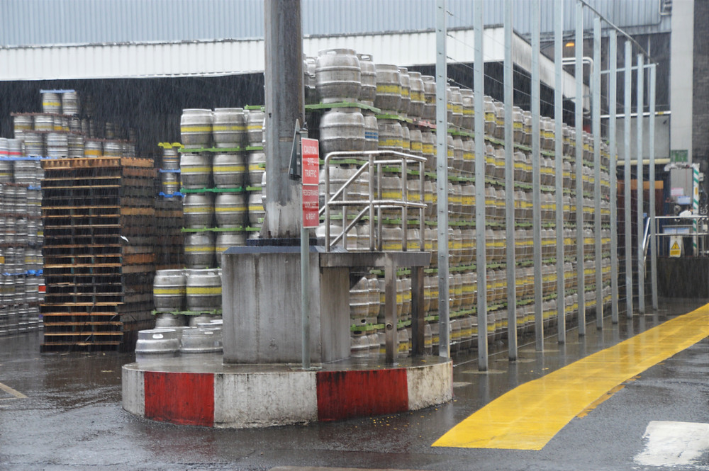 Empty kegs of Tennent Lager stored in the brewery yard in Glasgow