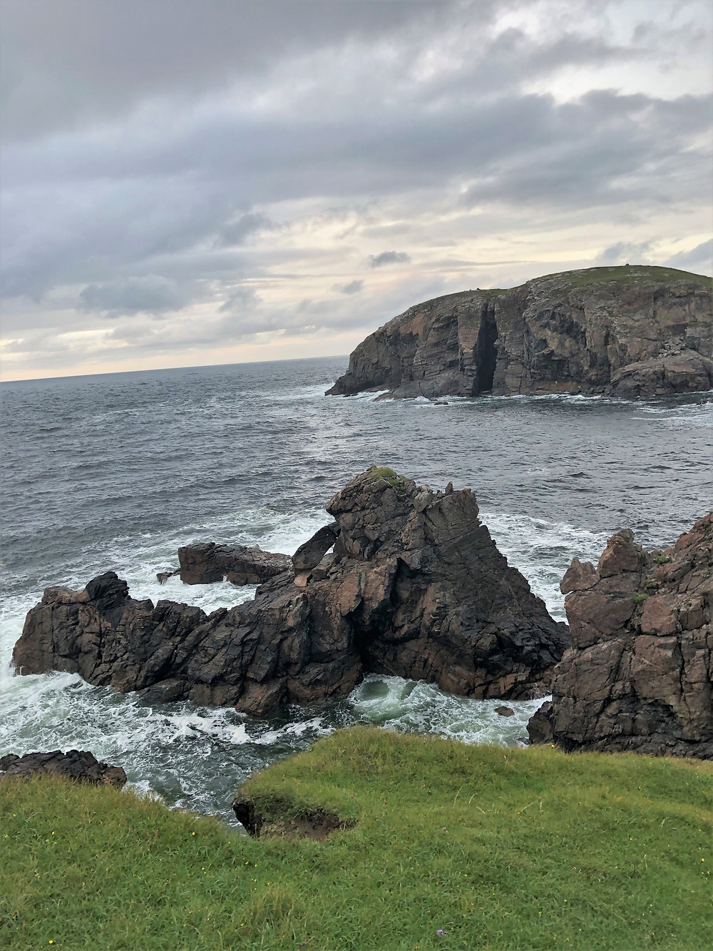 Rocky outcroppings and cliffs on Dalbeg beach in the north of Carloway on Lewis and Harris in the Outer Hebrides.