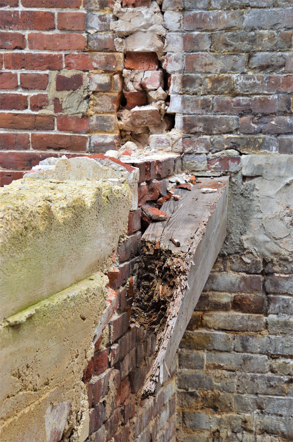 Broken wood support and cracked brick at the Nashua Manufacturing Co mill complex