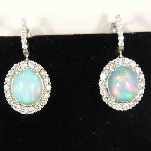 14 Kt White Gold Opal And Diamond Earrings These Beautiful Contain 2 Oval Shape Natural Opals That Measure 12 5 X 10 Mm Each Have A Total