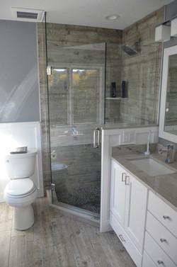 Wood like tile master bathroom