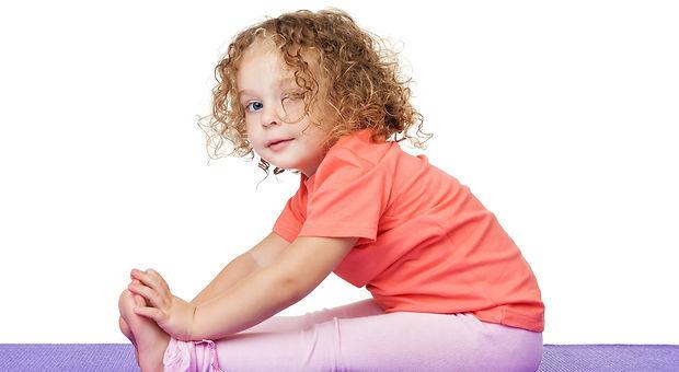 Little girl doing fitness exercises.jpg