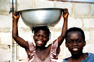 Stock-image-children-carrying-water-bowl