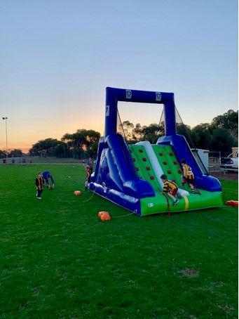 The Auskick kids enjoy the inflatables