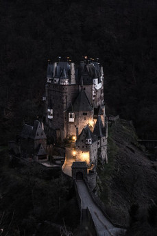 This German castle seen at night inspires the appearance of Ghoul School