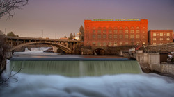 WWP building along the Spokane river at the falls