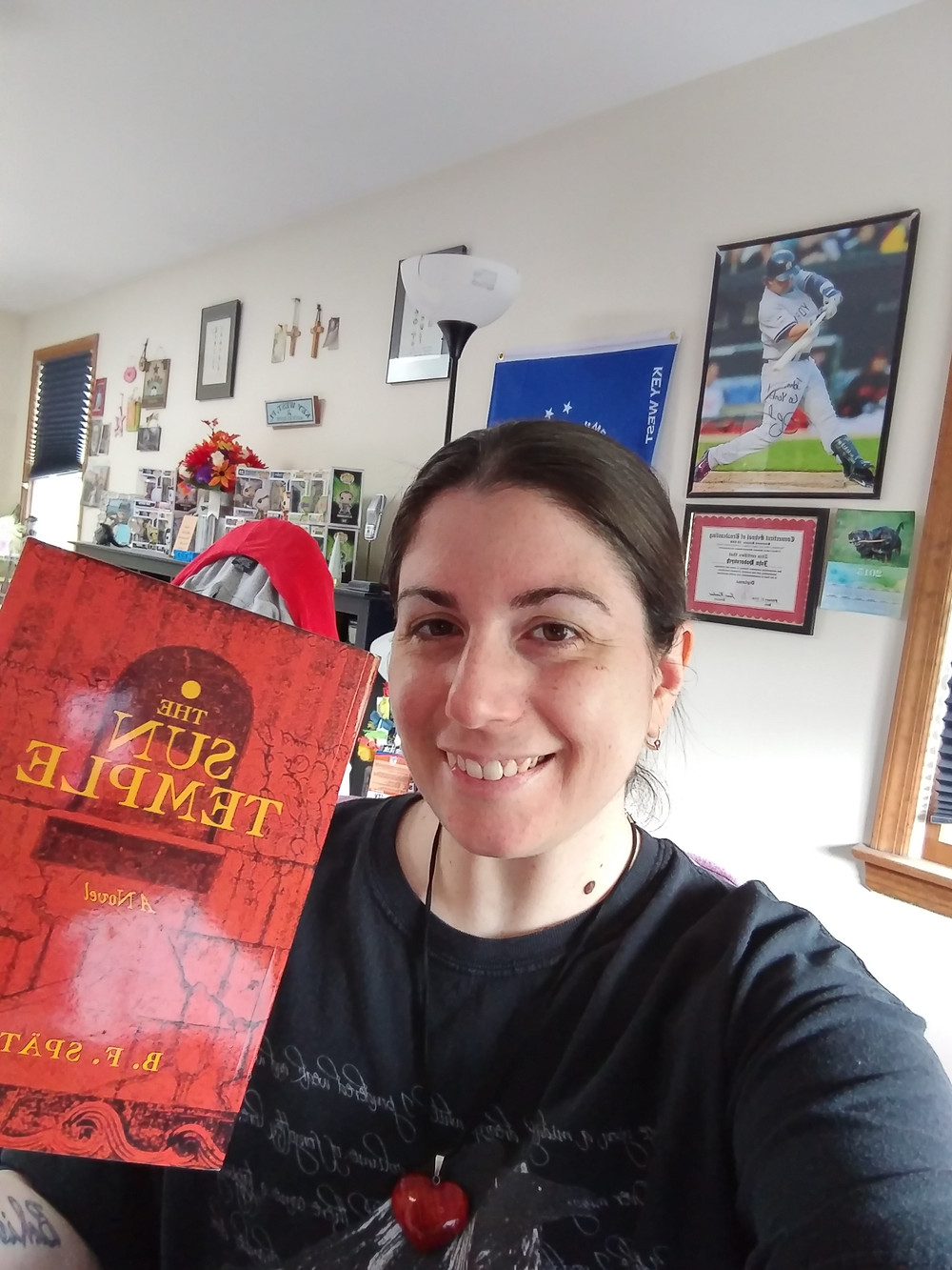 """Me with my copy of """"The Sun Temple"""" by B.F. Spath"""