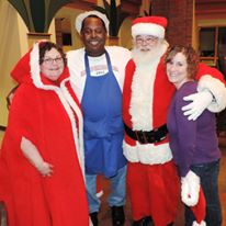 Pastor Stein with Chris Brenner, Santa and Mrs. Claus