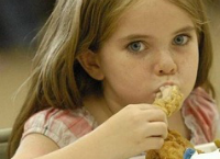 Girl Eating Chicken