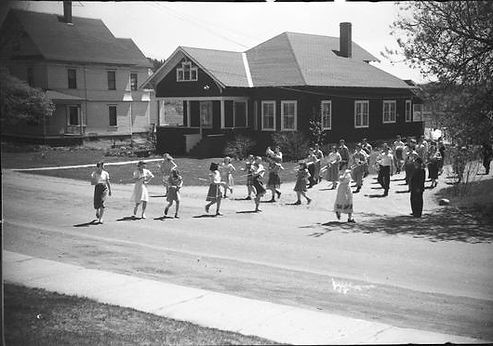 Canaan marching band coming out of the road to the school