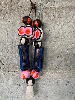 Grigri bijou de mur coloré numéro 6