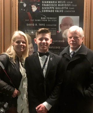 With my daughter Heather and grandson, Joshua in front of Carnegie Hall, NYC in 2019 after his performance with the Santiago H S Wind Ensemble, March 2019