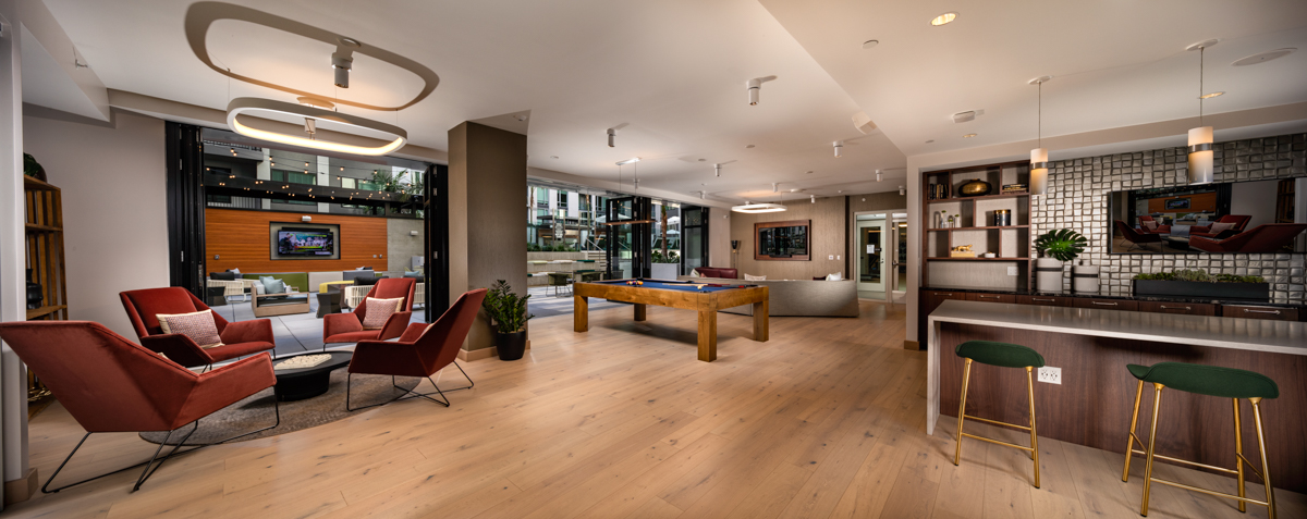 Trademark apartments recreation lounge with pool table and television