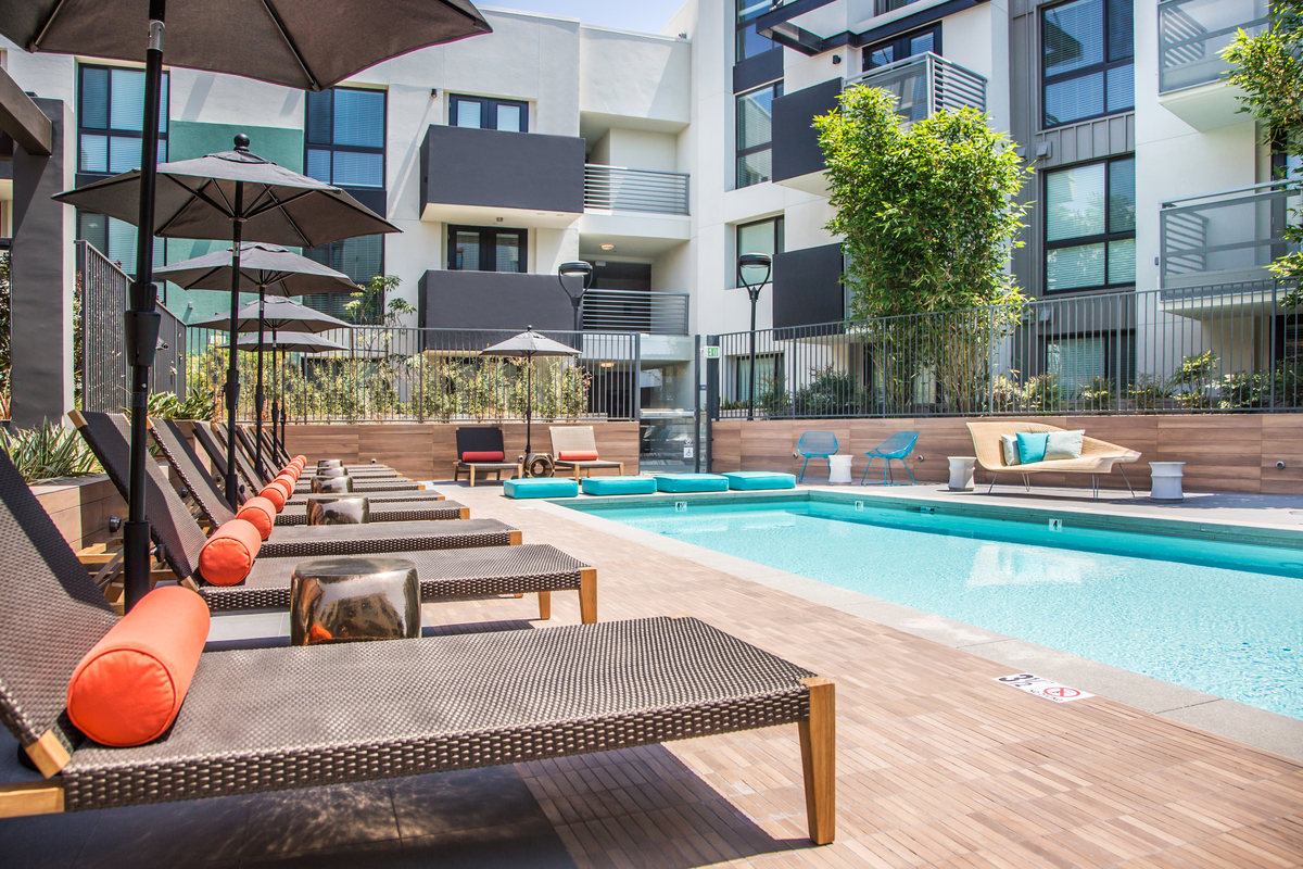 Outdoor swimming pools with umbrellas Access Apartments