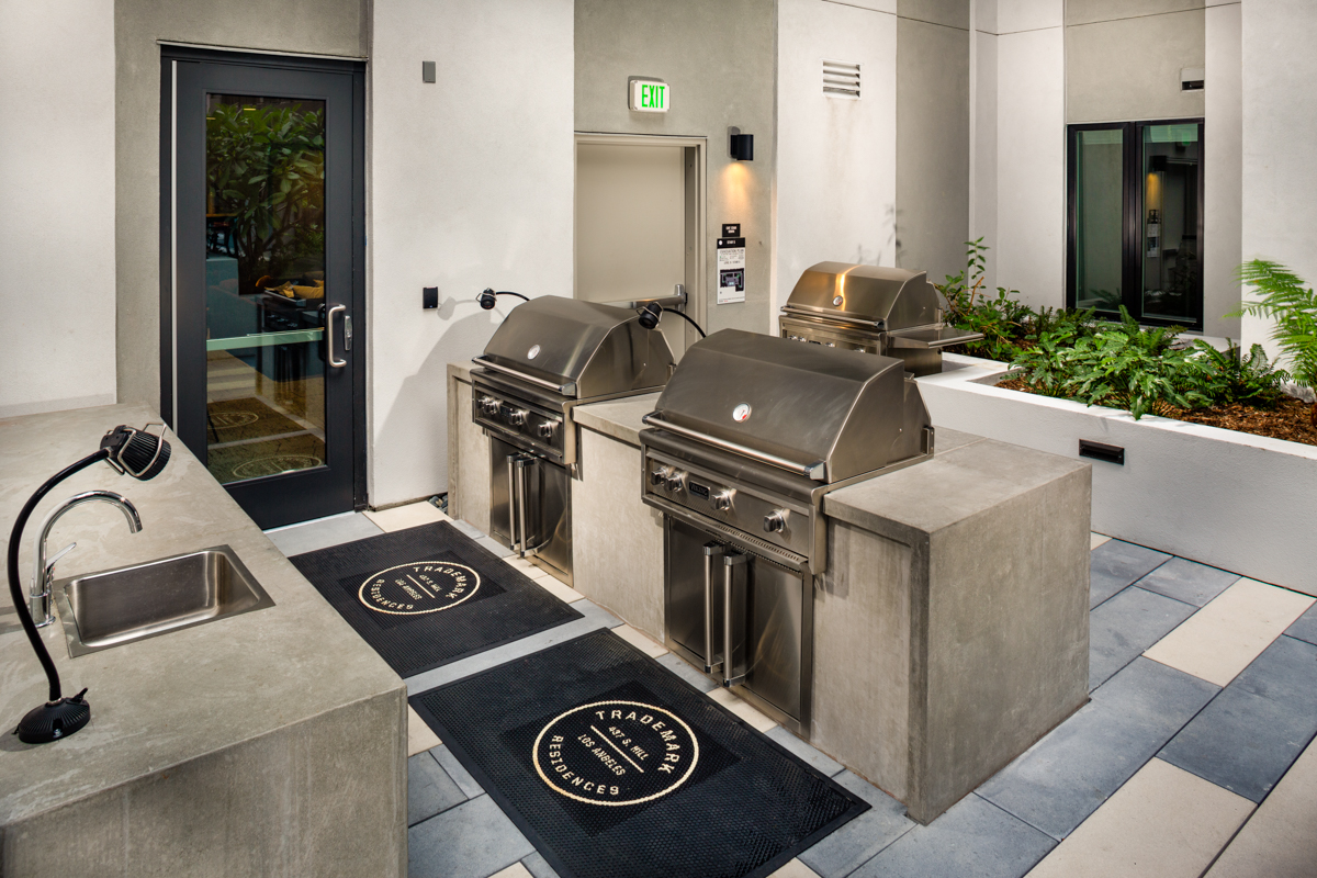 Trademark Apartments outdoor barbeque area with sink