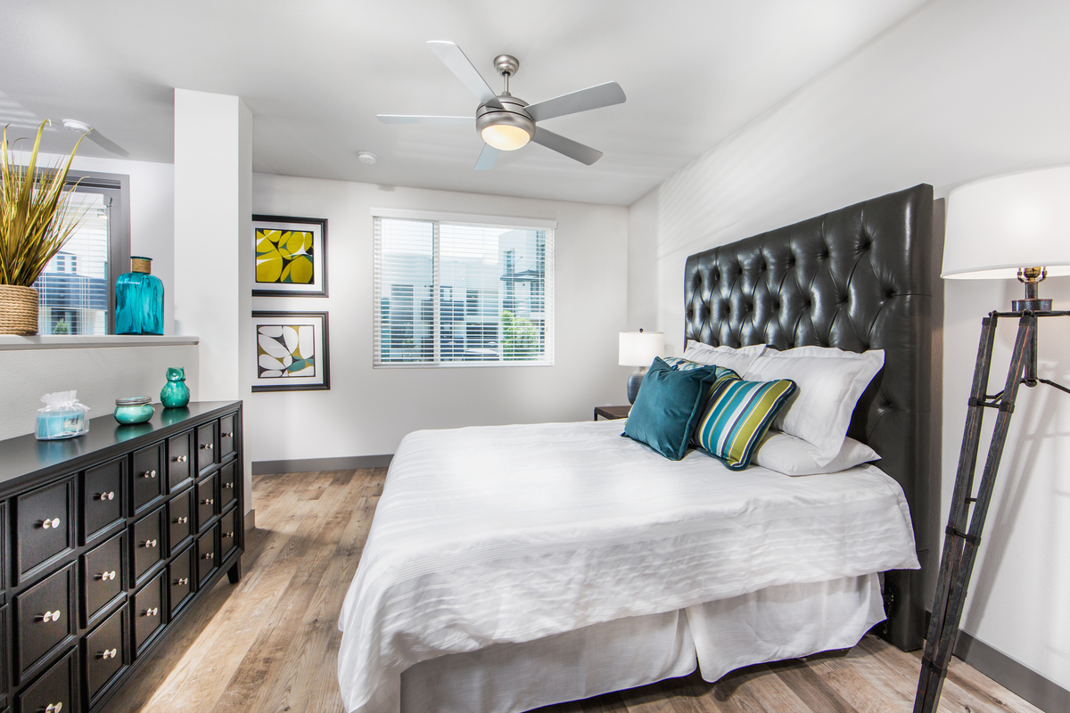 Access Apartments bedroom with queen bed