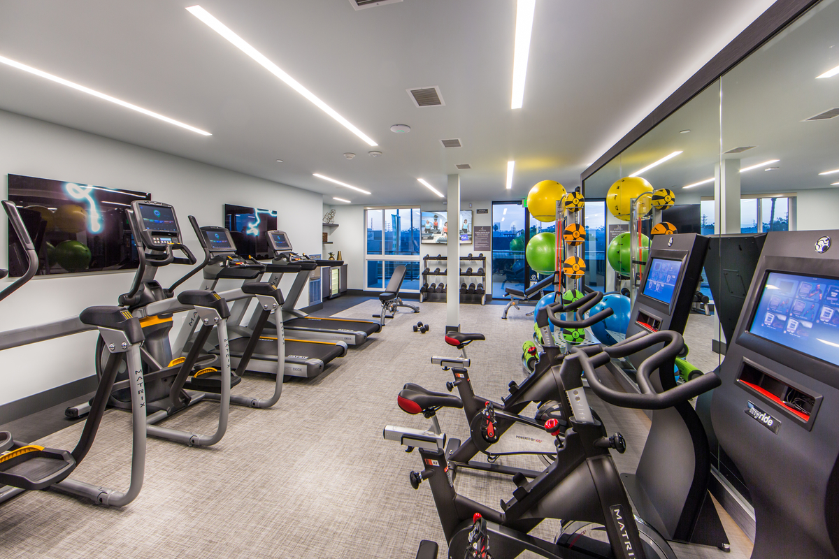 Access Apartments fitness center with bicycles and treadmills
