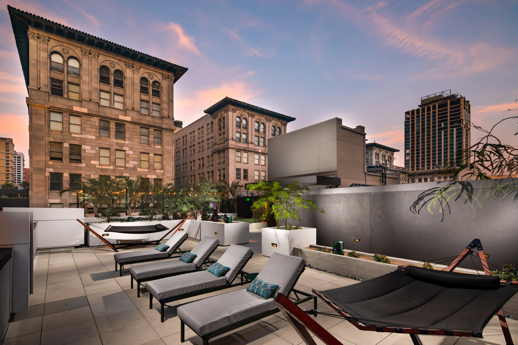 Trademark Apartments outdoor space with reclining chairs