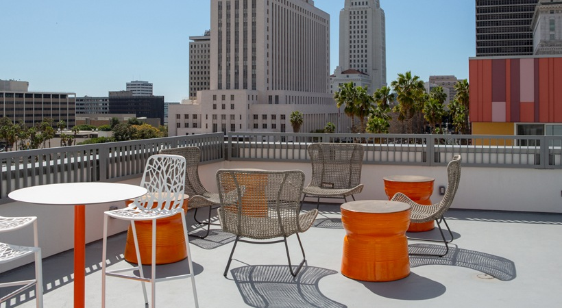 La Plaza Village Apartment outside seating area with view of Downtown Los Angeles