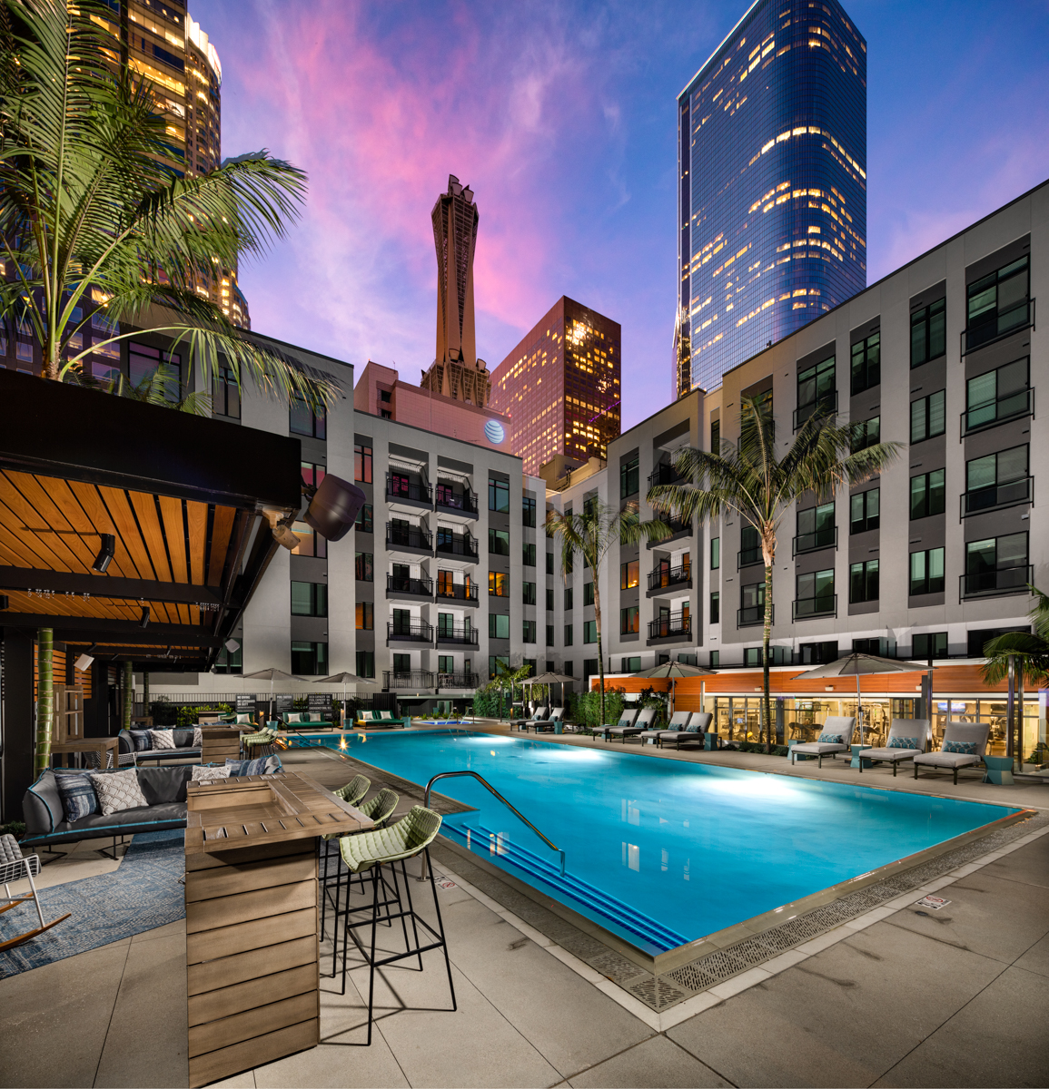Trademark Apartments outdoor swimming pool with views of highrises in Downtown Los Angeles