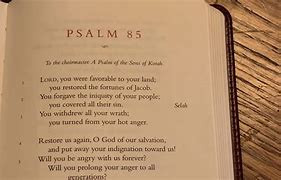 Bible open to Psalm 85