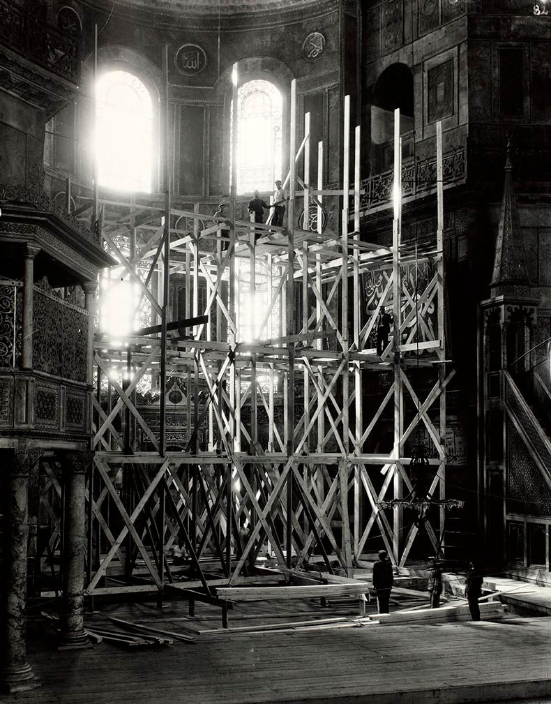 Here you can see them erecting a wooden scaffold to work on the apse mosaic and the marble revetment.  They would have done it the same way in Byzantine times when they put up the mosaics or repaired them.  They have covered the marble floor to protect it.  Constantinople was surrounded with forests and wood was always inexpensive and easy to harvest and transport to the city.  Most of the homes were built of wood.