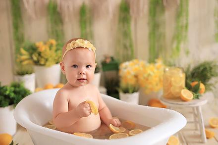 Happy little girl bathes in the bath. Ba