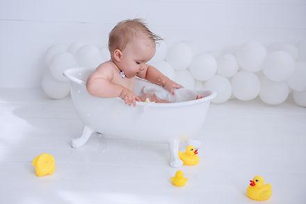 Little boy takes a bath. Water treatment