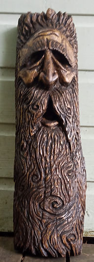 Wood spirit carving by Moon Rabbit Craftworks