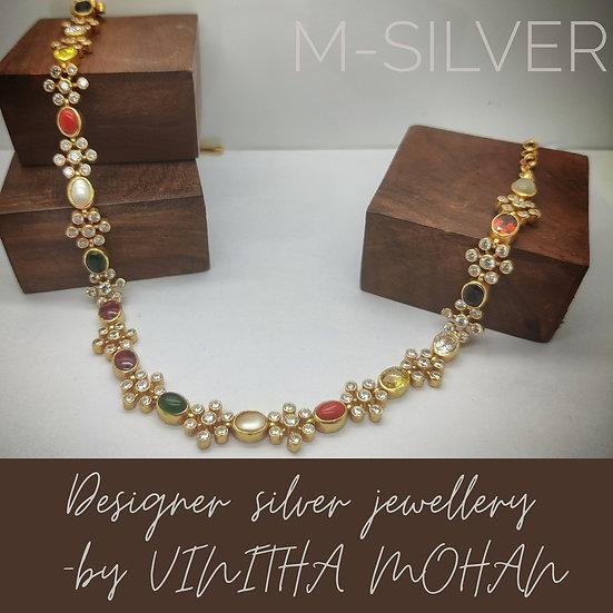 Short necklace with Navaratna stones.
