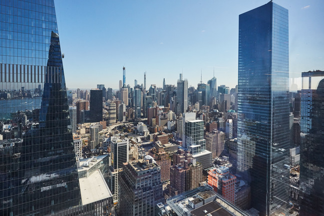 The exhibition took place in   a football yard on the 48th floor of the Hudson Yards viewing New York City.