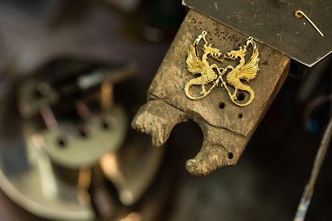 Dragon pendant on bench pin