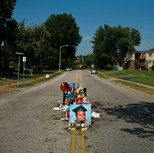 A memorial stood on the spot where Michael Brown was killed by the police in Ferguson, Mo.