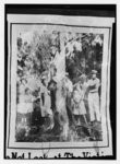 Lynching of R. Stacey - Fla. 1935 - Negro hanging from tree amid crowd of men, women, and children