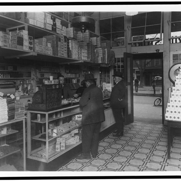 [Interior of People's Drug Store, 14th and U(?) Streets, Washington, D.C., with employees and customers]