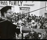 Mamie Bradley speaking to anti-lynching rally after the acquittal of men accused of killing her son, Emmett Till, Harlem, NY