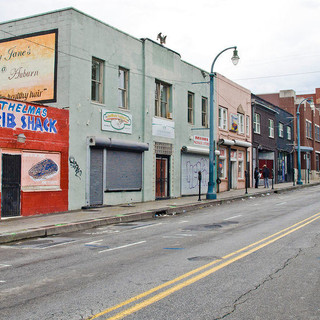 Businesses boarded up and abandoned on Auburn Avenue