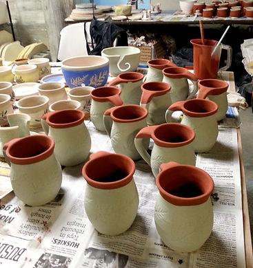 Mugs being glazed