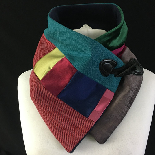 Red pink green and blue neck warmer