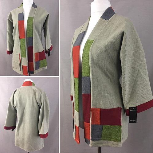 Beige textured kimono jacket with bright patchwork trim