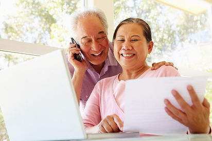 elder-filipino-look-at-bills.jpg