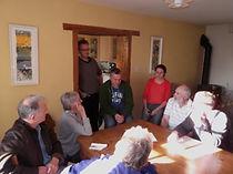 Helen Harrison (in red) meeting residents