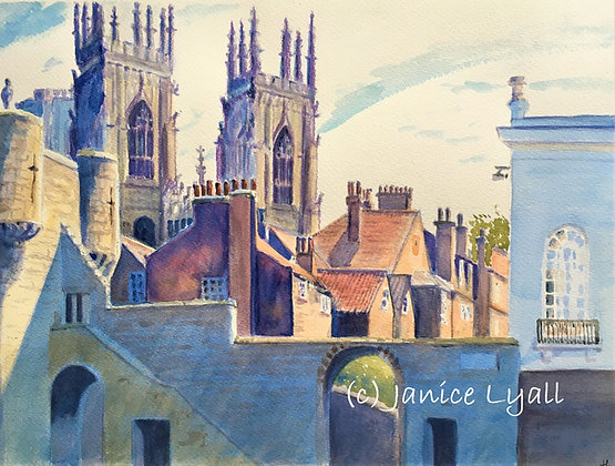 'York Minster towering over chimney pots'