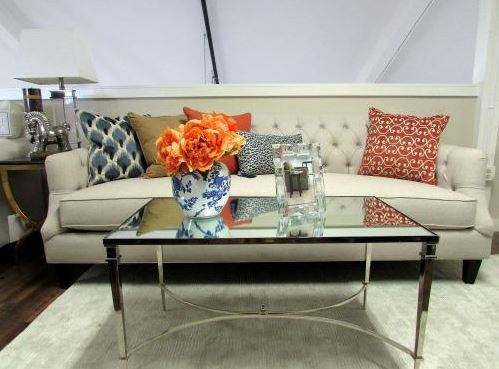 tufted sofa with patterned sofa accent pillows