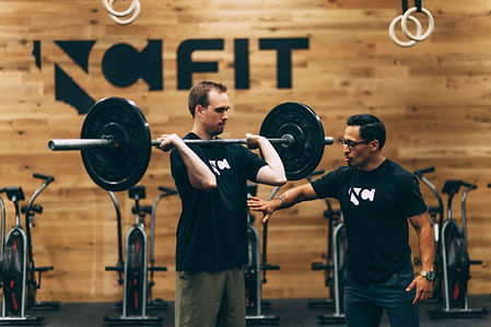 NCFIT_coach-instructing-olympic-lifting.