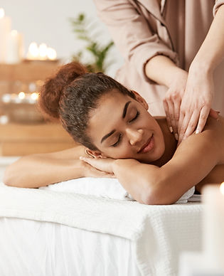 tender-african-woman-smiling-enjoying-massage-with-closed-eyes-spa-resort.dng
