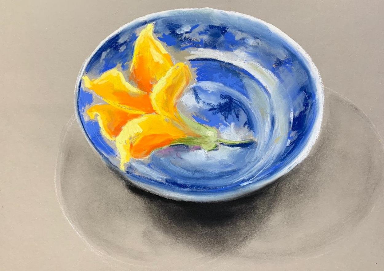 Yellow flower in dish