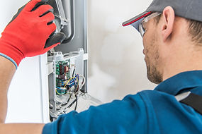 Technician Servicing Residential Heating
