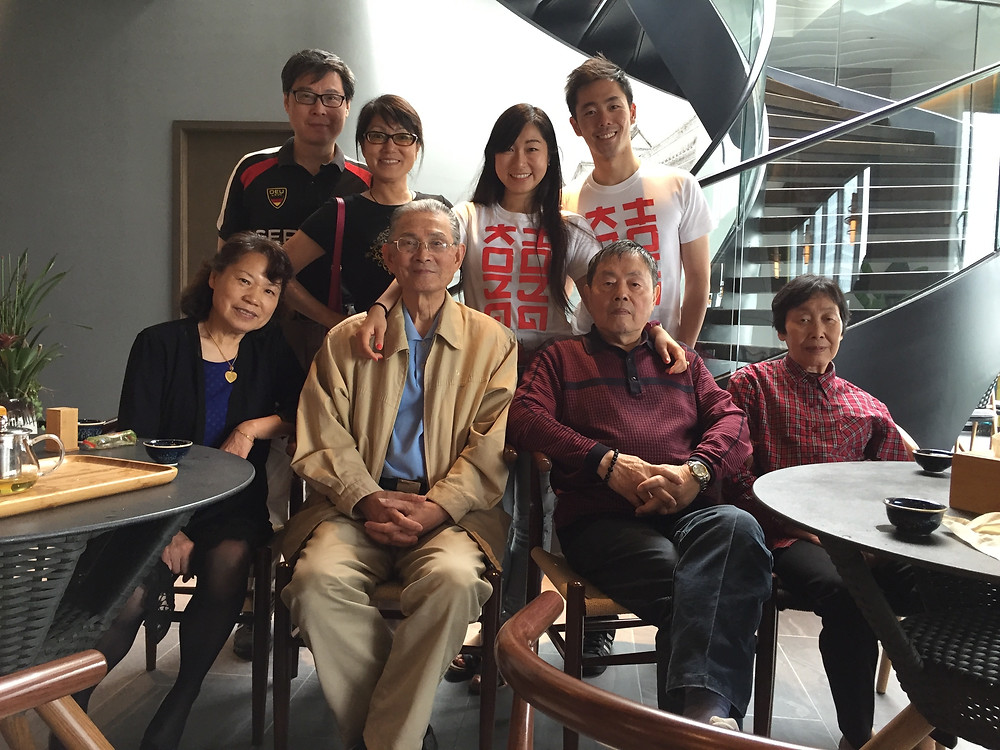Lucia in matching T-Shirts with her husband standing next to her parents, and behind her grandparents in Shanghai