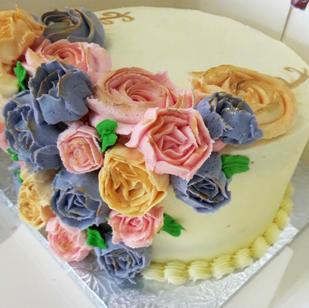Vanilla cake with multi coloured flowers